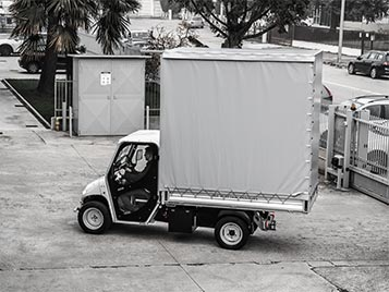 Vehicles With Body Tarp - Industrial Electric Vehicles